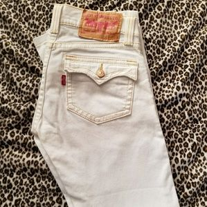 White levis 504 slouch boot cut jeans